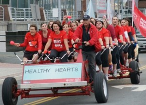 Nancy Murry (front and middle of the big bike), and her collegues on a bicycle built for 29!