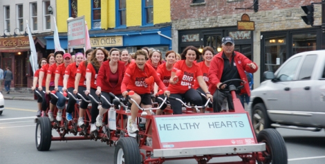 Eastern Health employees take a ride on the big bike to raise money for the Heart and Stroke Foundation.
