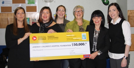 The BRIDGES Team holding the grant cheque from Canada Post.