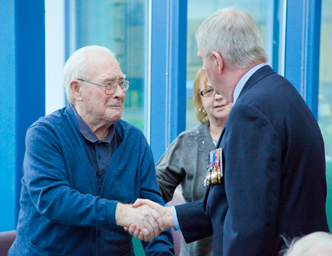 Veteran Edward Samson shakes hands with General (Ret.) Rick Hillier.