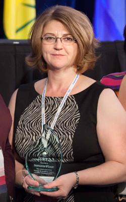 Bernadine holding her Award
