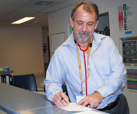 Dr. Etienne van der Linde, Site Chief of Emergency Medicine at the Dr. G.B. Cross Memorial Hospital
