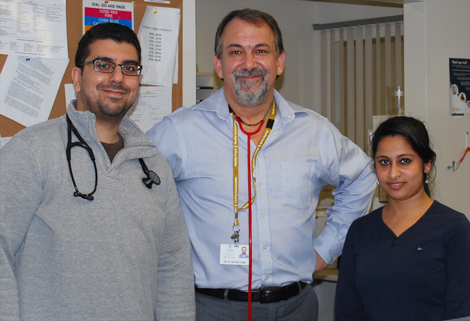 Dr. van der Linde with two members of his staff at the Dr. G.B. Cross Emergency Department. Left:  Dr. Ahmed Vaid (FP2 Resident). Right: Siji Alex, RN.