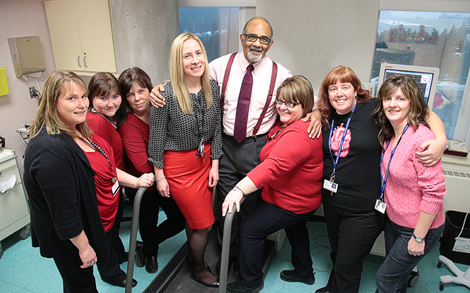 The Janeway Cardiology Team (l-r) Maureen Butler, cardiology technologist; Kim Breen, clerk; Tina Cole, administrative  assistant;  Dr. Heather  Bremner, cardiologist; Dr. Surya Shah, cardiologist; Charline Daley, nurse coordinator; Dr. Christina Templeton, cardiologist; and Tanya Button, cardiac sonographer. Missing from the photo: Nikita Hady, cardiac sonographer. Photo by Phil Simms.