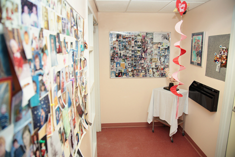 The walls of the Janeway Cardiology Clinic, which are decorated with photos from the many families who have been touched by childhood heart disease. Photo by Phil Simms.