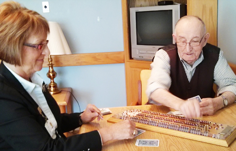 Social Worker Cathy Connors with Bill Jarvis, a resident at the Agnes Pratt Nursing Home, St. John's.