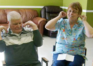 Dorothy Gullage, recreation therapy worker, and resident John Edgar Brown.