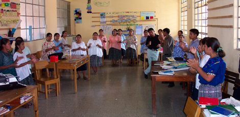 A group of Guatemalan student participate in a team building exercise.