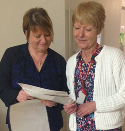 (l-r) AnnMarie consults with Licensed Practical Nurse Dianne Petten.