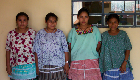 Four nursing students of Ixcán, Guatemala have their picture taken after class.