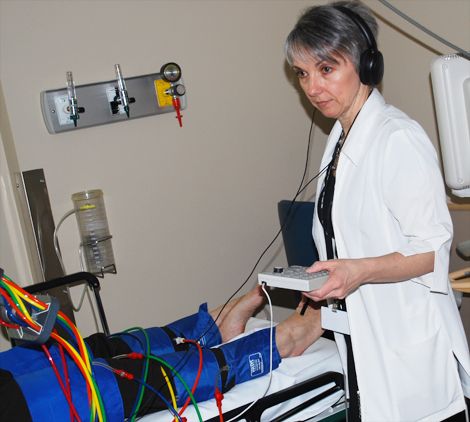 Denise Dinn, registered vascular technologist  tests blood pressure levels on patient.