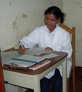 A nursing student from Coban, Guatemala engages in her studies.