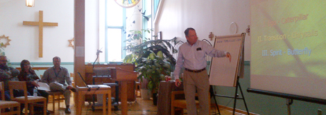 Dr. Tom Legere, speaking with pastoral care workers at Waterford Chapel.