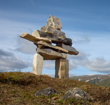 The inuksuk is a stone figure in the shape of a human being— one of the most powerful symbols of the Inuit culture. Copyright © 2014 Nunatsiavut Government.