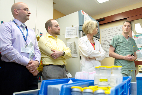 (l-r): Andrew Collins, clinical pharmacist, and Ryan Lethbridge, Denise Woodford, and James Lacey, pharmacy technicians, during one of the team's weekly meetings.