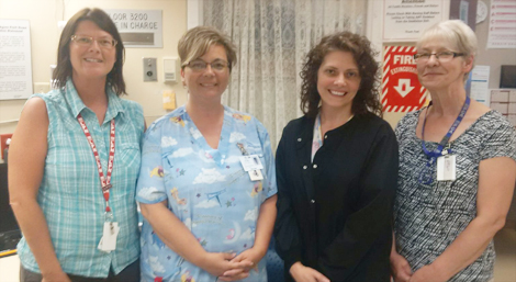 Members of Lucy's care team at Agnes Pratt Nursing Home: (l-r) Ramona Sturge, licensed practical nurse (LPN); Kim Power, LPN; Linda Dalley, registered nurse; and Isabel Brazil, personal care attendant.