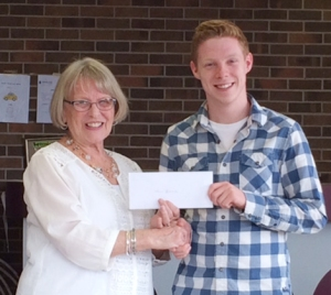 (l-r) Lona Warren, president of the General Hospital Auxiliary, presents a $500 scholarship to Sean Leonard, Eastern Health volunteer.