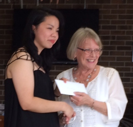 (l-r) Alicia Wong, Eastern Health volunteer accepts a $500 scholarship from Lona Warren, president of the General Hospital Auxiliary.