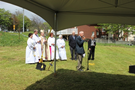(l-r) Rev. Donna Mercer, Chaplain and Priest in Charge, St. Mary's Church;  Most Rev. Frederick Hiltz, Primate of the Anglican Church of Canada; Rt. Rev. Dr. Geoffrey Peddle, Bishop of Eastern Newfoundland and Labrador; Archdeacon Sandra Tilley; Hilary Lewis, Eucharistic Assistant, St. Luke's Home; Bruce Tilley, Councillor, City of St. John's; Ms. Kate Moffatt, Executive Director, Program Delivery and Policy, Research and Monitoring, Newfoundland and Labrador Housing Corporation; Dr. Robert Sexty, Board Member of Anglican Homes Inc. (at microphone)