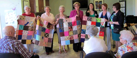 Members of the Ocean View Quilters Guild (l-r) Helen Duff, Margaret Wade, Donna Nolan, Janice Dalton and staff with Eastern Health's Personal Care Home Program (l-r) Sandra Williams, Judy Peddle and Cathie Barker Pinsent display touch quilts for residents of Admiral's Coast Retirement Home in Kelligrews.