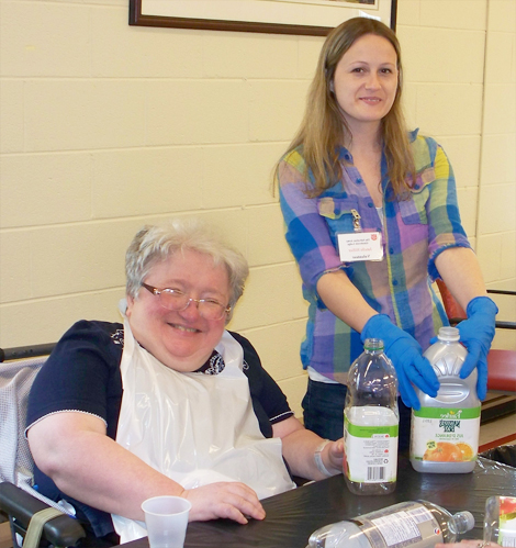(l-r) Carol Green, long-term care resident and Janelle Hillier, medical service aide with Eastern Health, make sure cans and containers are cleaned and ready to go to recycling to raise funds for wheelchairs.