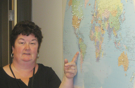 Sandra Milmore, Release of Information employee, pointing to Peru on the map!