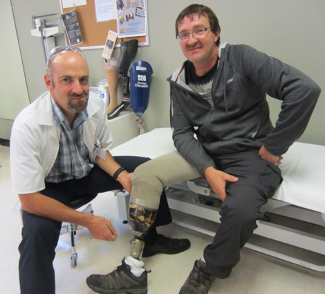 Prosthetist Martin Berthiaume puts the final touches on fitting Jim Glavine with his new leg at Eastern Health's Amputee Clinic.