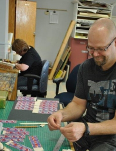 Students Greg Taylor and Angela Hennebury (background) at Open Windows Studio