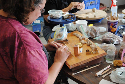 Open Windows Studio student Tony Rabinowitz working with clay