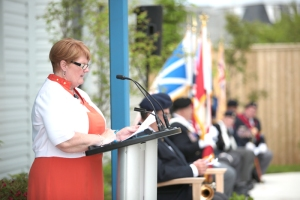 Sharon Nolan emcees opening of Jim Shields Garden, July 2014