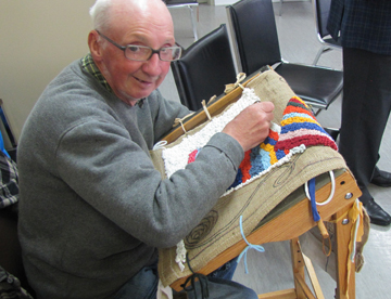 Group member Dinny Coady hooking a mat.