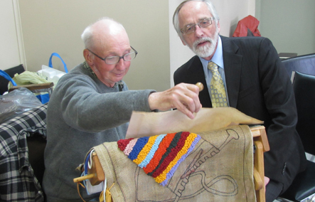 Dinny Coady showing interim President and CEO Don Keats his work.