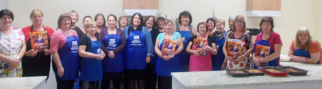 Ladies of the Placentia West 50+ club and the Parkers Cove Ladies Social Club on the Burin Peninsula preparing recipes with Regional Nutritionist Melissa Caravan (1st person, left, back row)