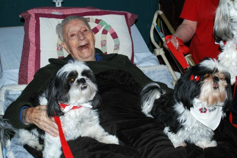 Caribou Pavilion resident Gerald Greenslade during a visit with the therapy dogs