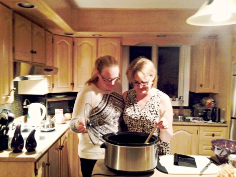 Victoria Piercy, dietetic intern at Eastern Health, and her mom, Karen, using the slow cooker.