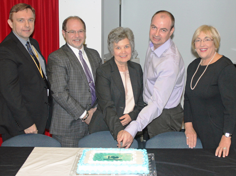 Cutting the 10th year anniversary cake (l-r) David Diamond, President and CEO of Eastern Health; Paul Snow, President and CEO of the Health Care Foundation; Kathy Corbett, founder of Comfort in Care™; Paul Bryne, Chair of the Comfort in Care™ Committee; and Debbie Patten, chair of the Health Care Foundation's Board of Trustees.