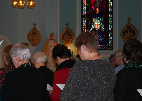 Members of the congregation bow their heads in prayer during the recent closing ceremony