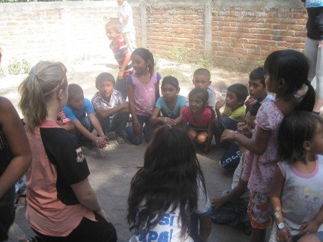 Jessica in Honduras with some of the community's children in 2014 with the Global Brigades.
