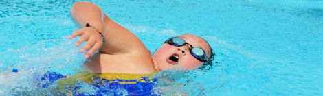 Child enjoying swimming pool