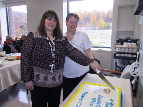 (l-r) Kelli Davis, manager of the medicine/surgery, ambulatory care and chemotherapy program and Margaret Duffitt, care facilitator, cutting the cake to celebrate the official opening of the Sunshine Supportive Care Rooms.