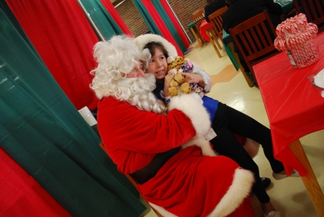 Sammi-Jo snuggles with Santa, December 2015