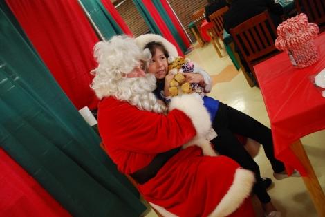 Sammi-Jo snuggles with Santa, December 2015