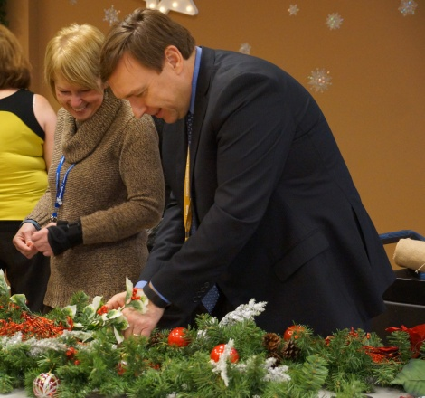 Director Joy Thompson and President and CEO David Diamond decorating at the St. John's Long-Term Care Facility