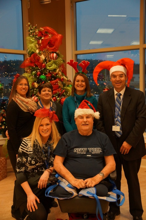 Long-term care staff gather for a photo with a resident in the multi-purpose room: Top (l-r): Nancy Hodder, Lisa Tobin, Judy O'Keefe and Sean Pardy Bottom (l-r): Rebecca Maloney and Kevin Hynes