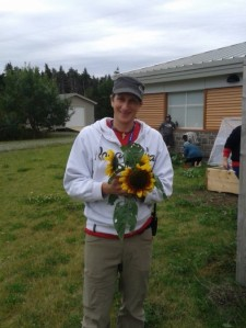 Blair Trainor, employee at Tuckamore Centre, shows off sunflowers grown by the Gardening Program.