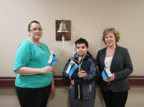 Nicolas Clarke, centre, the first patient to ring the Bell of Hope in Happy Valley-Goose Bay, with other patients (l-r) Renee Hanrahan and Valerie Rachwal.