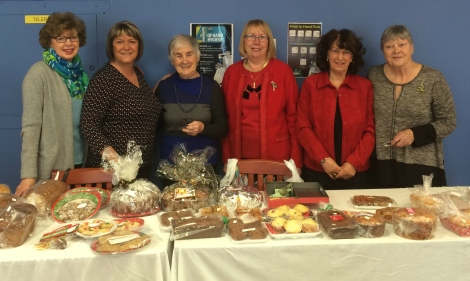 Members of the St. Clare's Mercy Hospital Auxiliary at a bake sale during December 2015