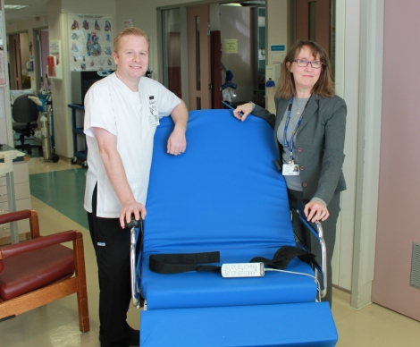 (l-r) Colin Saunders, registered nurse at St. Clare's Mercy Hospital ICU and Judy Kay with the stretcher chair.