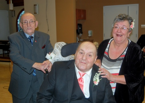 The new Mr. and Mrs. O'Brien pose with Carm's dad, William Jarvis (left).