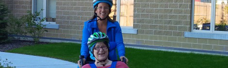 (l-f) Therapeutic Recreation Development Specialist Nancy Hodder and resident Donna Ellsworth riding the duet bicycle outside of the St. John's Long-Term Care facility
